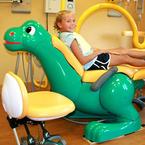 Girl in dinosaur chair