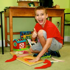 Boy playing with puzzle